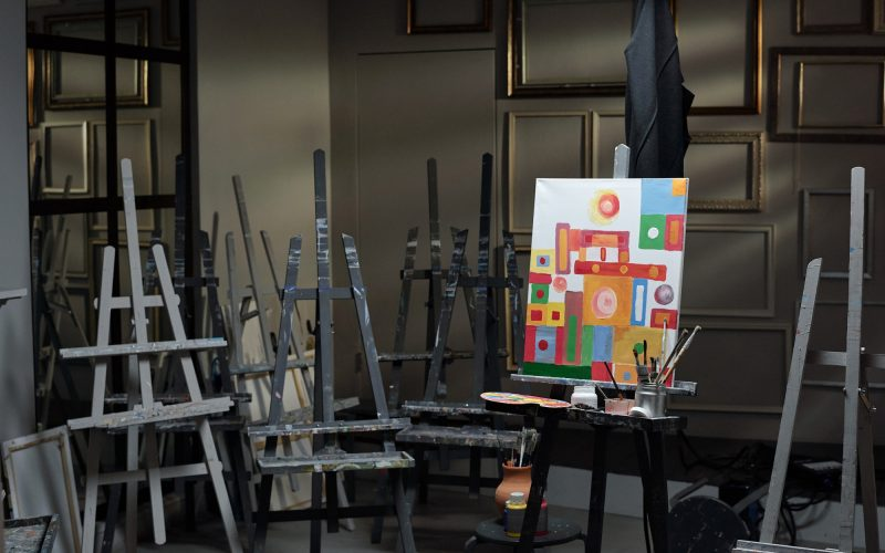 Interior of classroom in contemporary art studio with group of easels